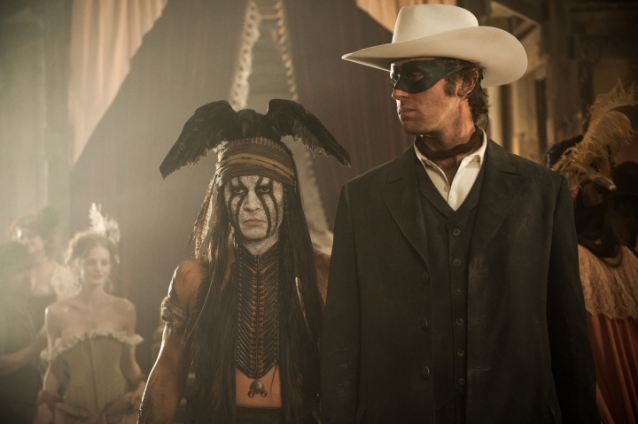 ©Disney Enterprises, Inc. and L to R: Johnny Depp as Tonto and Armie Hammer as The Lone Ranger Jerry Bruckheimer Inc.  All Rights Reserved.