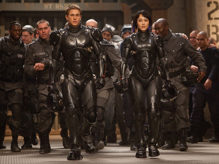COURTESY OF WARNER BROS. PICTURES (Front l-r) CHARLIE HUNNAM as Raleigh Beckett and RINKO KIKUCHI as Mako Mori in Warner Bros. Pictures' and Legendary Pictures'