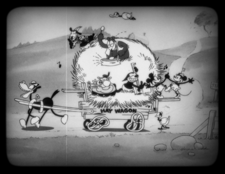 Mickey Mouse (voiced by Walt Disney himself), his favorite pal Minnie Mouse and a host of friends delight in a musical wagon ride in Walt Disney Animation Studios'