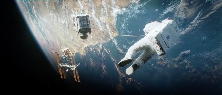 "Copyright: (C) 2013 WARNER BROS. ENTERTAINMENT INC. Photo Credit: Courtesy of Warner Bros. Pictures Caption: A scene from Warner Bros. Pictures' dramatic thriller ""GRAVITY,"" a Warner Bros. Pictures release."